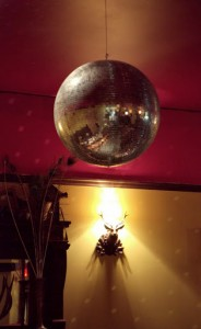 Disco balls at home with warm, vintage decor