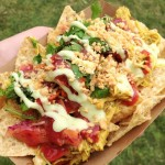 Creative Malaysian nachos from Azalina's w/ curry chicken, yogurt, blueberry sauce, peanuts