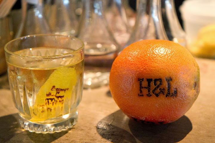 Hook & Ladder's special brand branded via iron onto citrus peels
