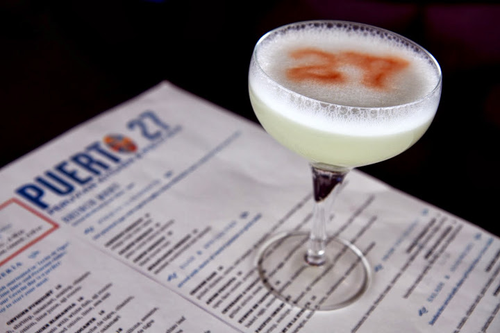 Pisco Sours with 27 drawn with bitters