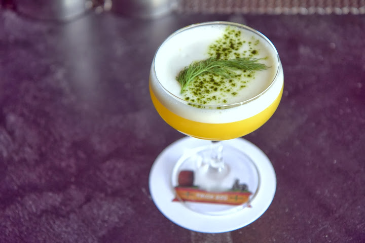 My favorite: Libra, lively, light, savory, brilliant with Tequila Ocho Plato Blanco, tangerine, dill, lime, egg white and a dusting of matcha green tea powder