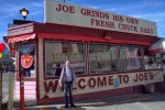 Joe Obegi in front of his iconic burger joint on its last day