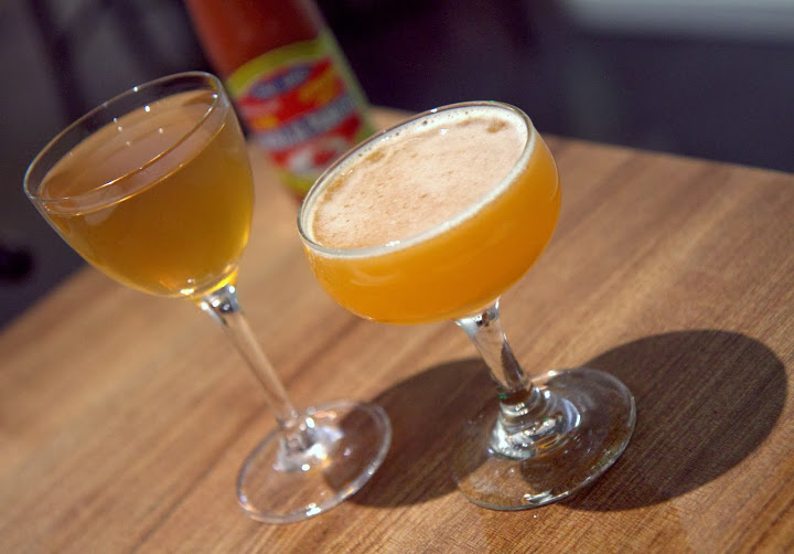Sao Thai (Thai Girl) on right: Ocho blanco tequila, house banana cordial, lime cinnamon Rasa Umami on left: Hidalgo Oloroso sherry, Black Grouse Scotch, house turmeric lime cordial, white pepper