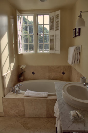 Modern tub, old fashioned windows looking out over Carmel rooftops