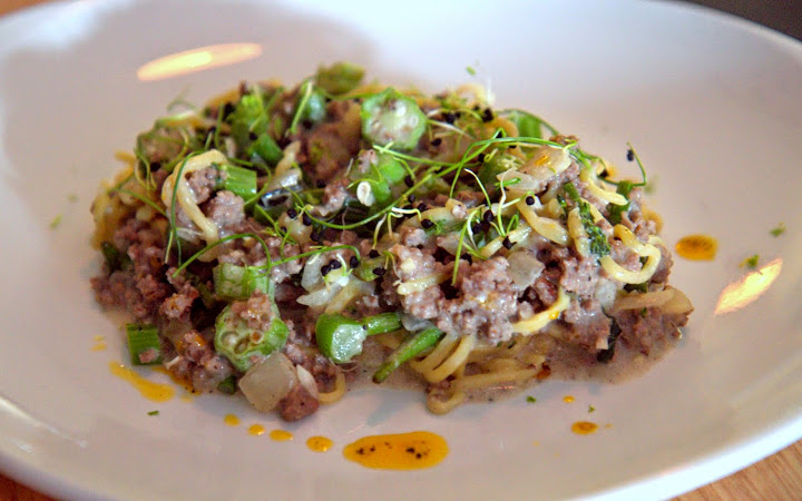 Tinatak ($14) handmade capellini noodles, ground chuck/beef, sugar snap peas, okra, lemon, beans?, coconut milk sauce