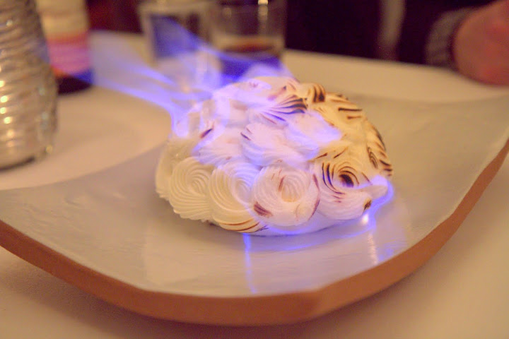 Dessert is a Baked Alaska flambeed with rum tableside, then sliced up & brought out; it's a molasses rum raisin caramel cake filled with vanilla ice cream then served in fennel or apple sauces we chose at the beginning of the meal as flavor profiles via punch card