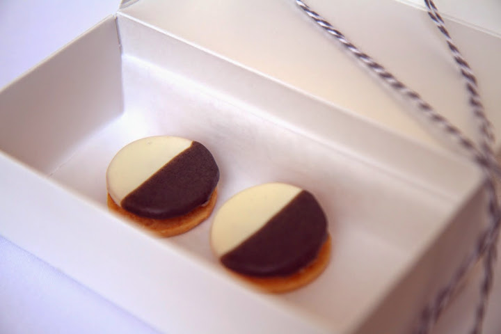 The first bite: soft, savory black & white cheese-apple cookies arrive in a box tied by striped string; the meal ends with a similar box & identical cookies but sweet with cinnamon