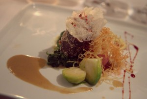 Hazelnut-crusted venison loin, horseradish potatoes, foie gras & chestnut sauce with G Sake Fifty