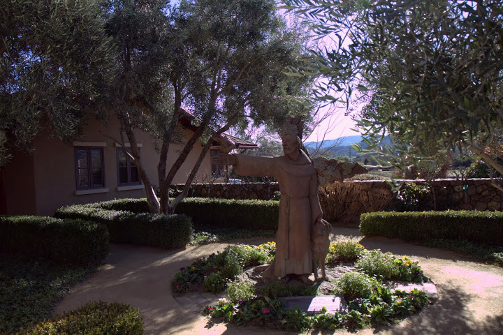 A peaceful garden surrounding a statue of St. Francis with his beloved animals (namesake of the winery and the city of San Francisco)