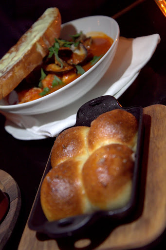 Cafe Du Nord's Parker House rolls with cioppino