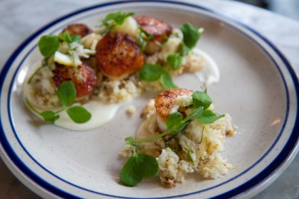 Comstock Saloon's day boat scallops ($22) and shredded cauliflower in lemon relish and galangal ginger sauce